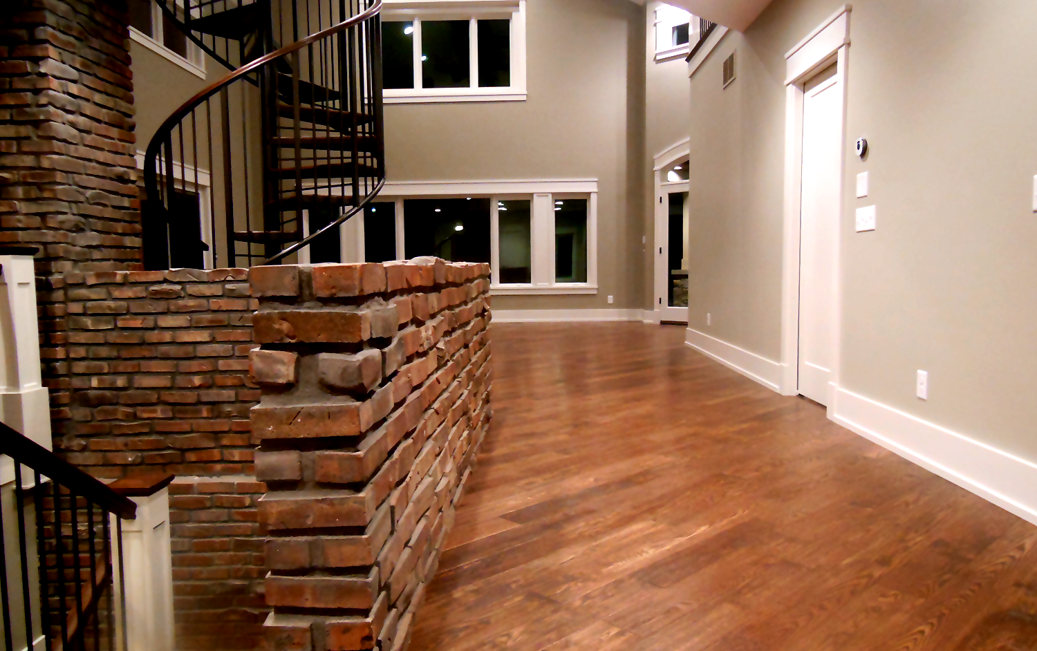 Hallway of Custom Home With Brick Features
