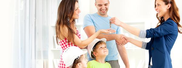 Family receiving keys during through home walkthrough