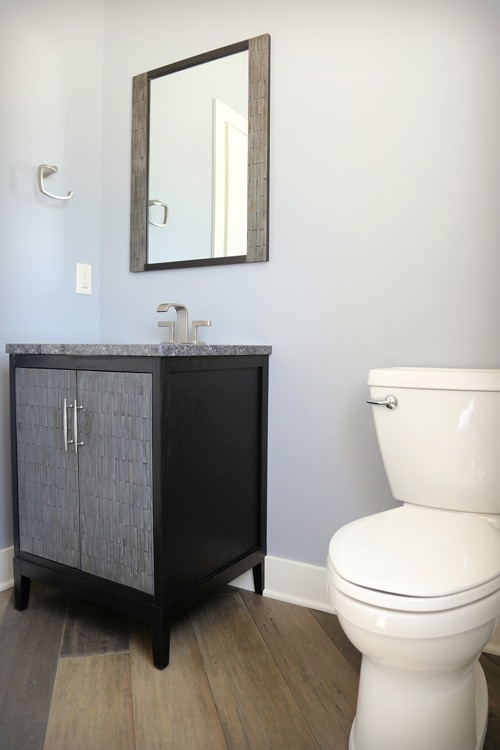 Half bath with matching vanity and mirror frame