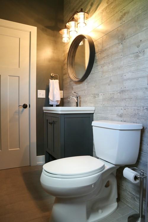 Rustic bathroom with wood slatted wall