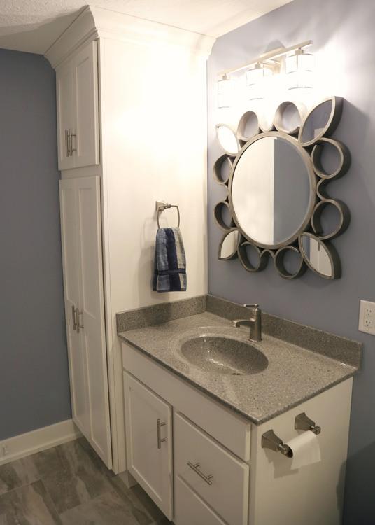 Bathroom vanity with decorative mirror