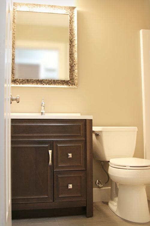 Full bathroom with dark wood vanity