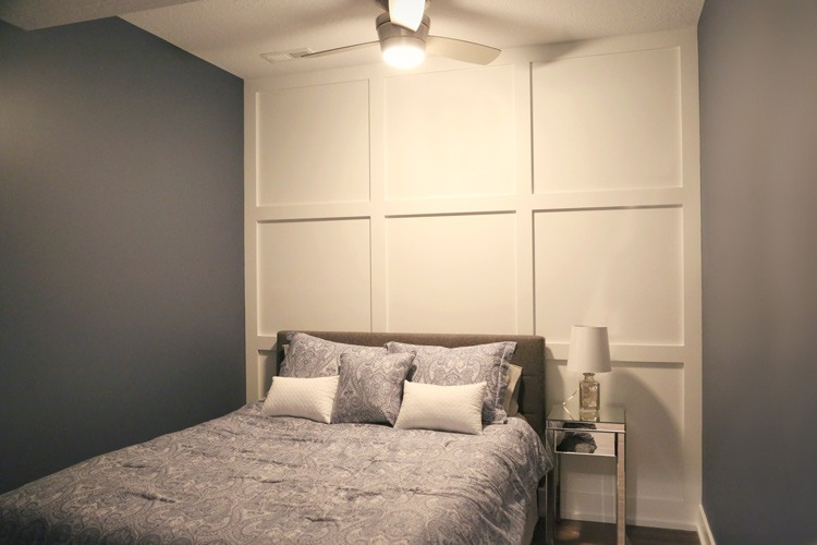 Bedroom with custom wood designed wall