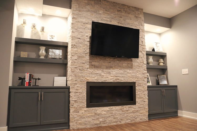 Basement entertainment center with stone wall