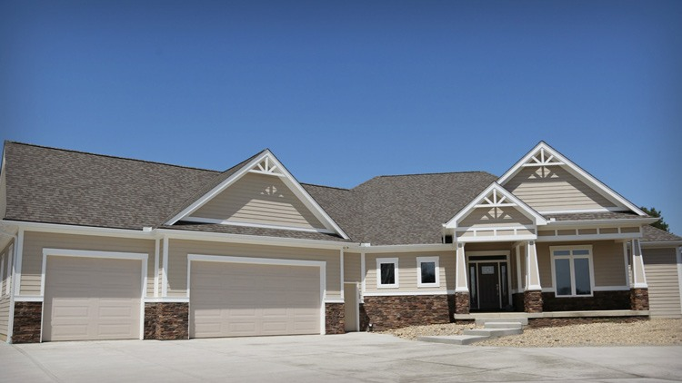 Front view of custom home with attached 3 car garage