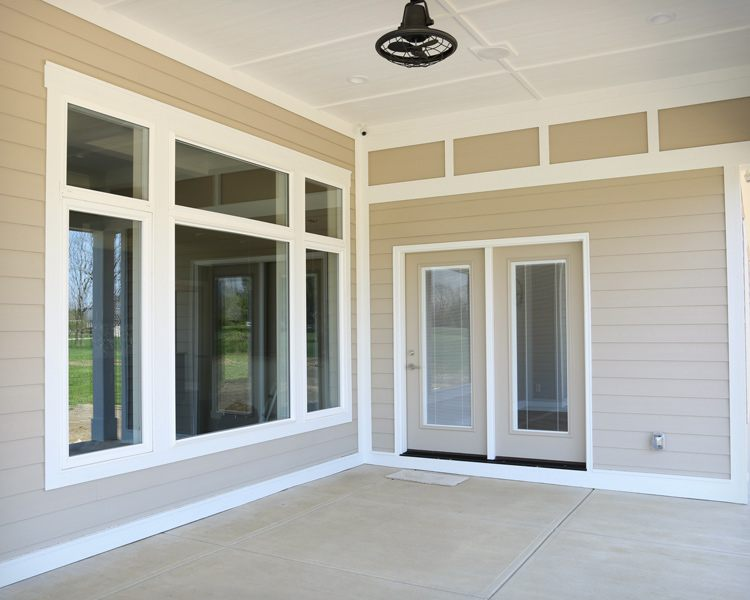 Covered patio area with side entrance to home