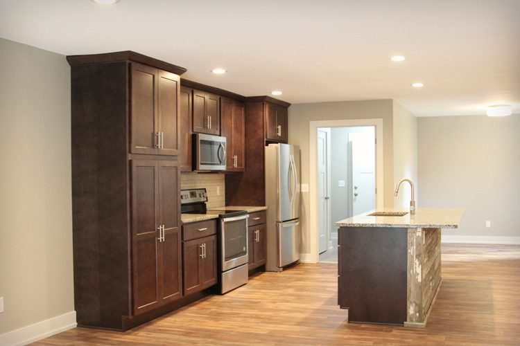 Rustic kitchen side view with dark wood cupboards
