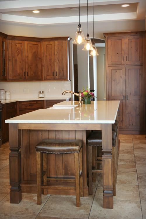 Kitchen island with wrap-around bar seating