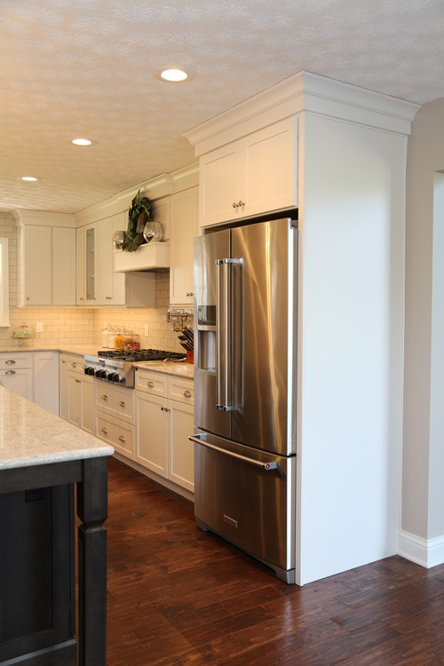 Kitchen with white cupboards and subway tile backsplash