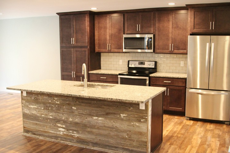 Rustic kitchen with distressed wood on island front