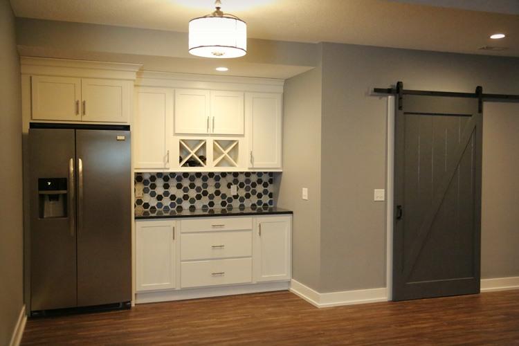 Basement kitchenette with sliding barn door