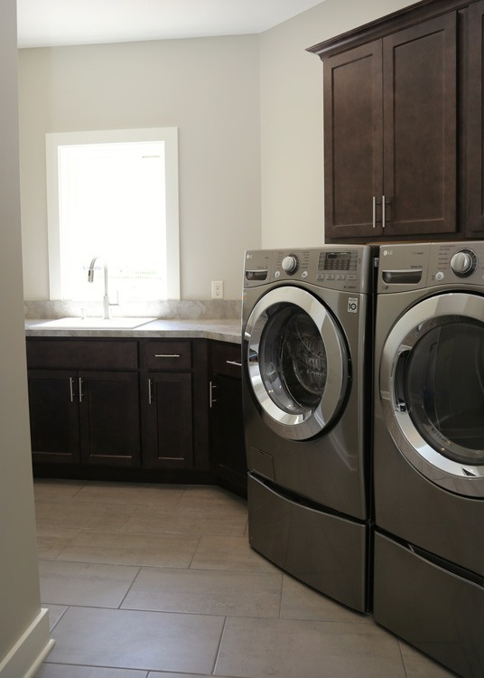 Laundry room with sink and storage cupboards