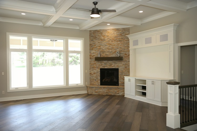 Living room with large front windows and fireplace