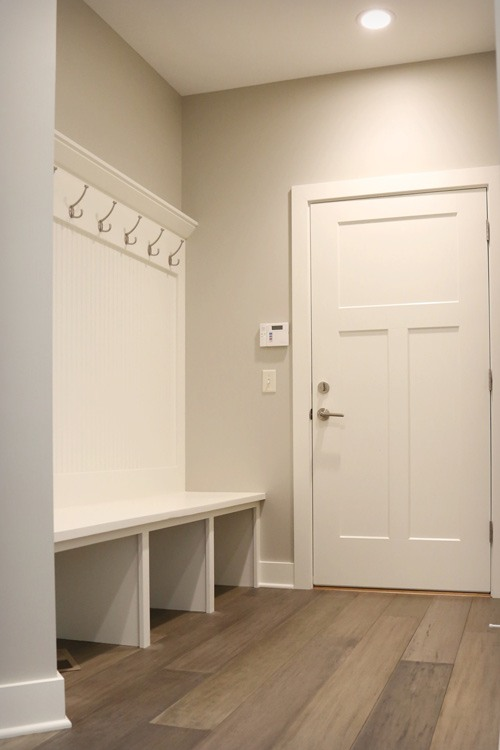 Mudroom entry with coat hooks and storage
