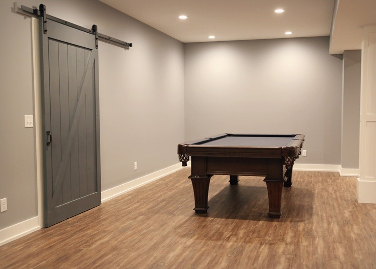 Downstairs pool table area with sliding barn door